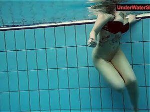 inked baby swirls underwater