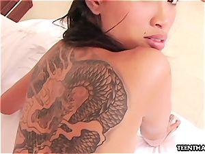 Thai bitch with tats doggie-style penetrating